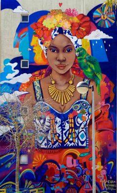 Mural mujer con canario Eva Bracamontes